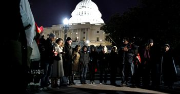 People gather for a candlelight vigil for the victims of the shooting in Arizona at the steps of Capitol Hill    AP photo/Jose Luis Magana