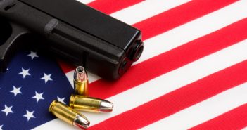 gun over american flag_featured