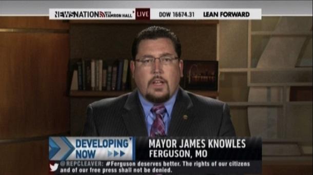 Photo of Ferguson mayor blasts Holder after cops shot